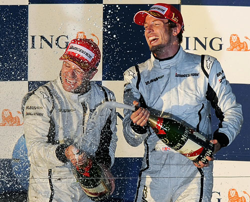 Jenson Button and Rubens Barrichello celebrate after the Australian Grand Prix