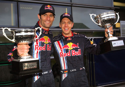 Mark Webber and Sebastian Vettel celebrate Red Bull's first ever 1-2