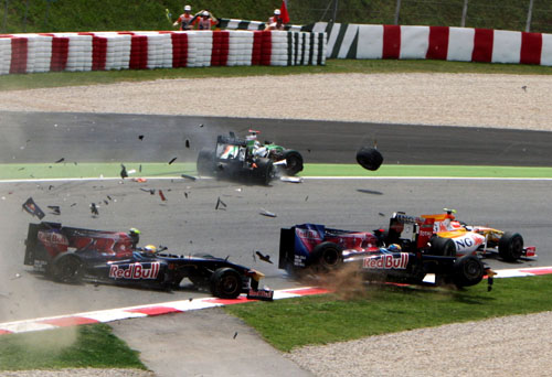 Toro Rosso's Sebastien Buemi and Sebastien Bordais collide