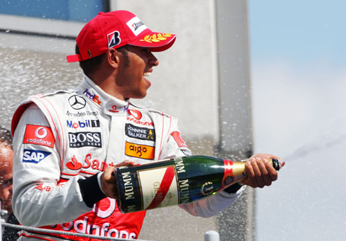 Lewis Hamilton celebrates his first race victory of the season