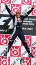 Race winner Sebastian Vettel leaps for joy on the podium