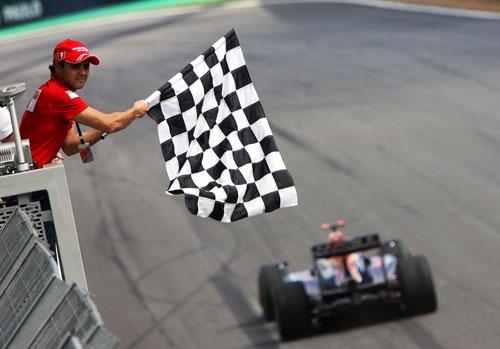Ferrari's Felipe Massa waves home race winner Mark Webber
