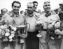 Alberto Ascari, Juan Manuel Fangio and Nino Farina after the British Grand Prix,