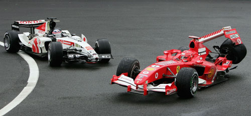Michael Schumacher collides with Takuma Sato