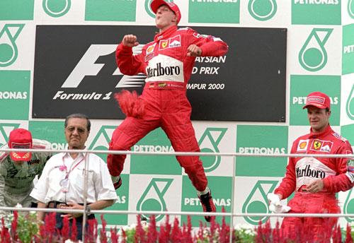 Michael Schumacher celebrates his win in the Malaysian Grand Prix
