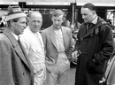 Peter Collins, Reg Parnell, Tony Brooks and Aston Martin team manager John Wyer