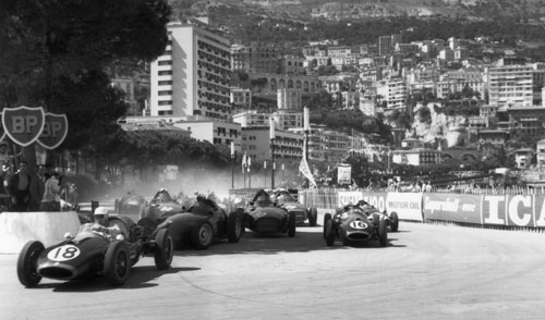 Cars battle for space on the track at a closely fought corner in the early stages of the Monaco Grand Prix