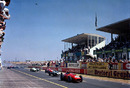 The field roars off led by the Ferrari 246/F1 of Tony Brooks