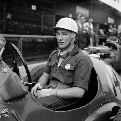 A young and rather pensive Stirling Moss sits in his HWM-Alta before practice