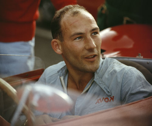 Stirling Moss sitting in his Maserati 300S
