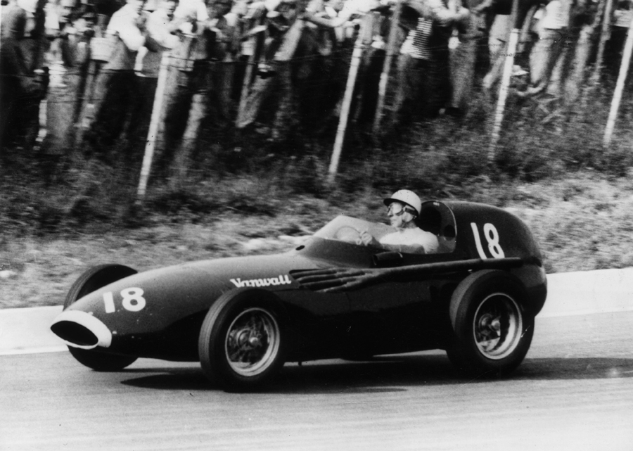 Stirling Moss driving a Vanwall to victory at Monza