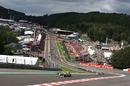 F1 cars file through Eau Rouge
