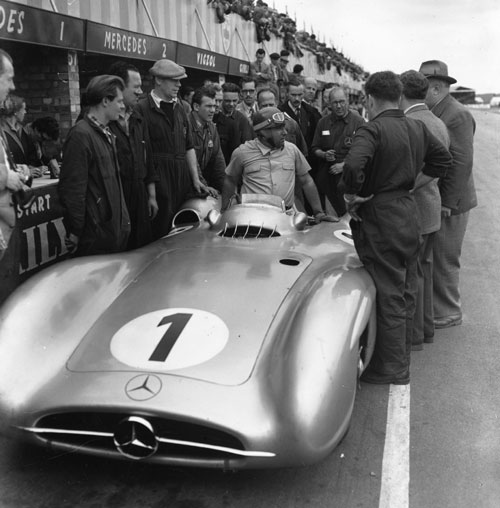 Juan Manuel Fangio getting out of his Mercedes