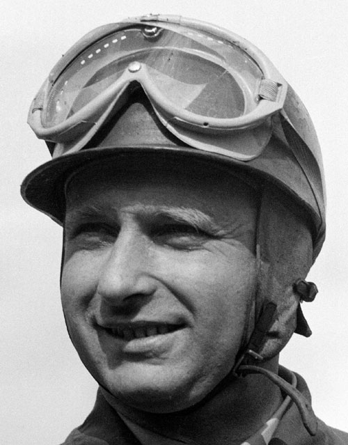 A pre-race portrait of Juan Manuel Fangio