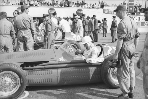 Stirling Moss in a Maserati at the start of the race