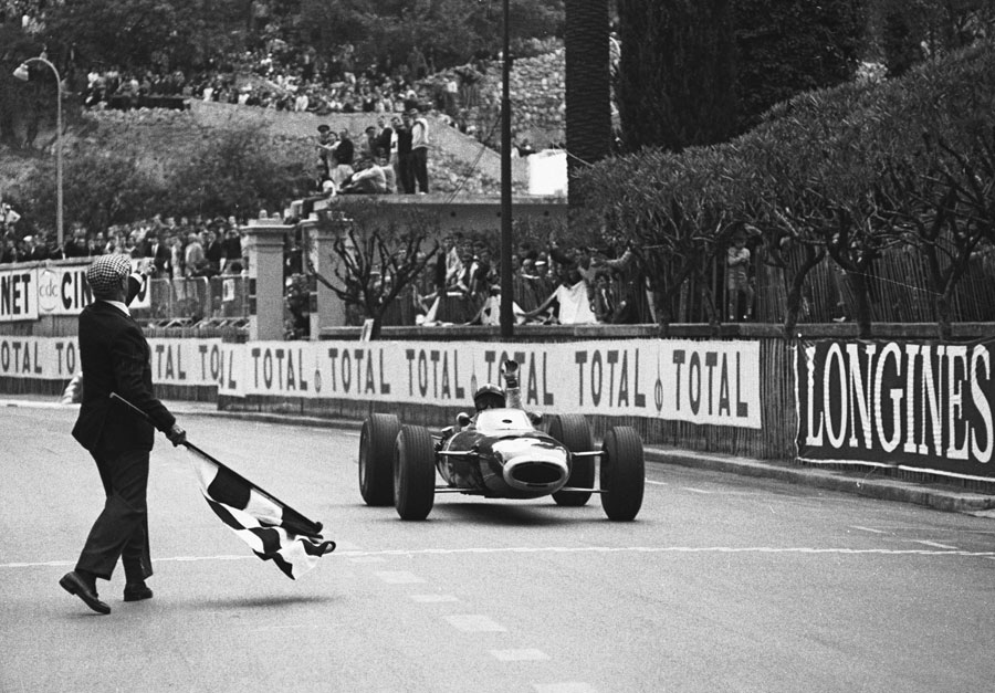 Graham Hill in his BRM taking the chequered flag