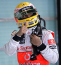 Lewis Hamilton celebrates after taking pole in Abu Dhabi