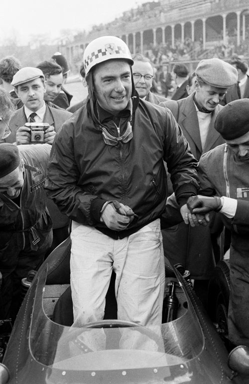 A delighted Jean Behra after winning the non-Championship BARC 200 race