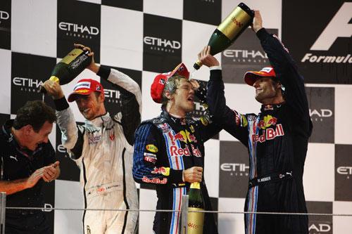 Christian Horner, Jenson Button, Sebastian Vettel and Mark Webber  celebrate on the podium