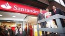 Lewis Hamilton helps chairman Emilio Botin open a newly-rebranded bank