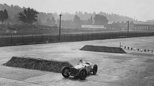 Robert Benoist driving a Delage practising his turns ahead of the inaugural British Grand Prix