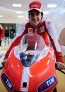 Fernando Alonso poses for photos on a MotoGP bike