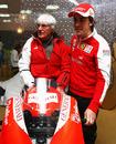 Bernie Ecclestone and Fernando Alonso pose with a MotoGP bike
