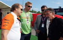 Robert Fearnley and Peter Schmeichel listen to Eddie Jordan before final practice