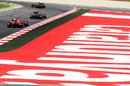 Vitaly Petrov leads Sebastian Vettel and Felipe Massa