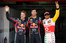 Mark Webber smiles with Sebastian Vettel and Lewis Hamilton after securing pole position