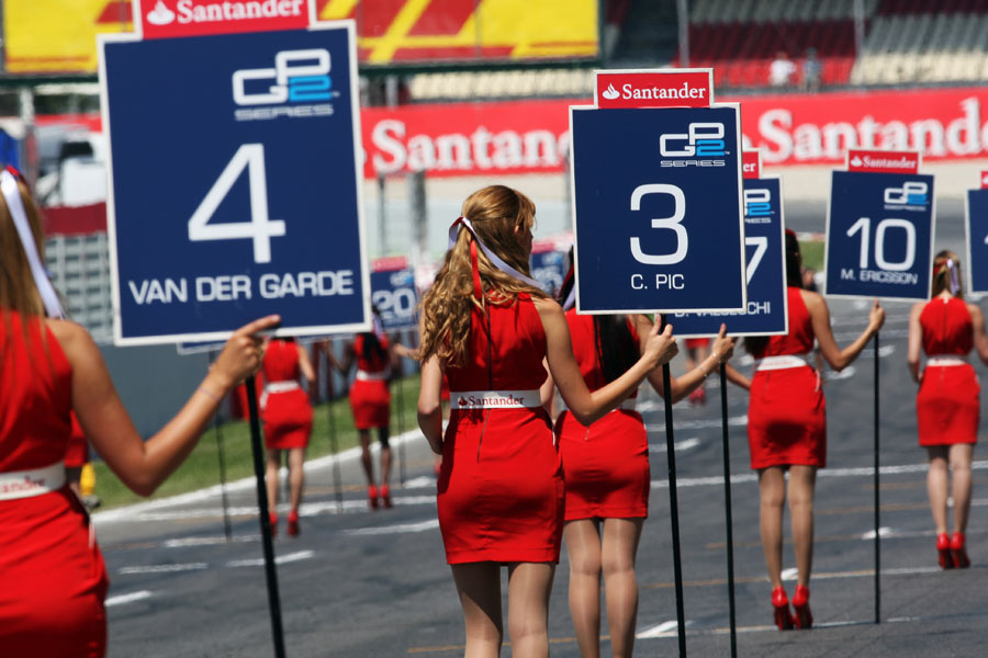 Grid girls head out for the start of the GP2 race