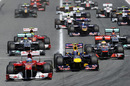 Fernando Alonso beats Mark Webber and the rest of the field down in to turn one