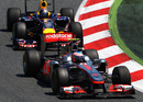 Jenson Button holds off Sebastian Vettel