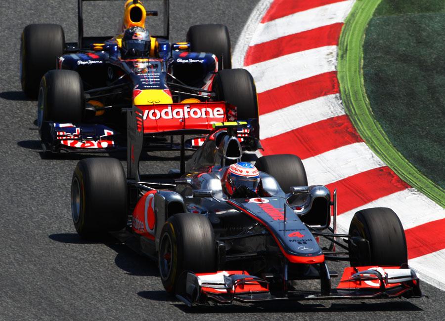 Jenson Button holds off Sebastian Vettel