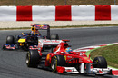 Fernando Alonso leads Sebastian Vettel early in the race