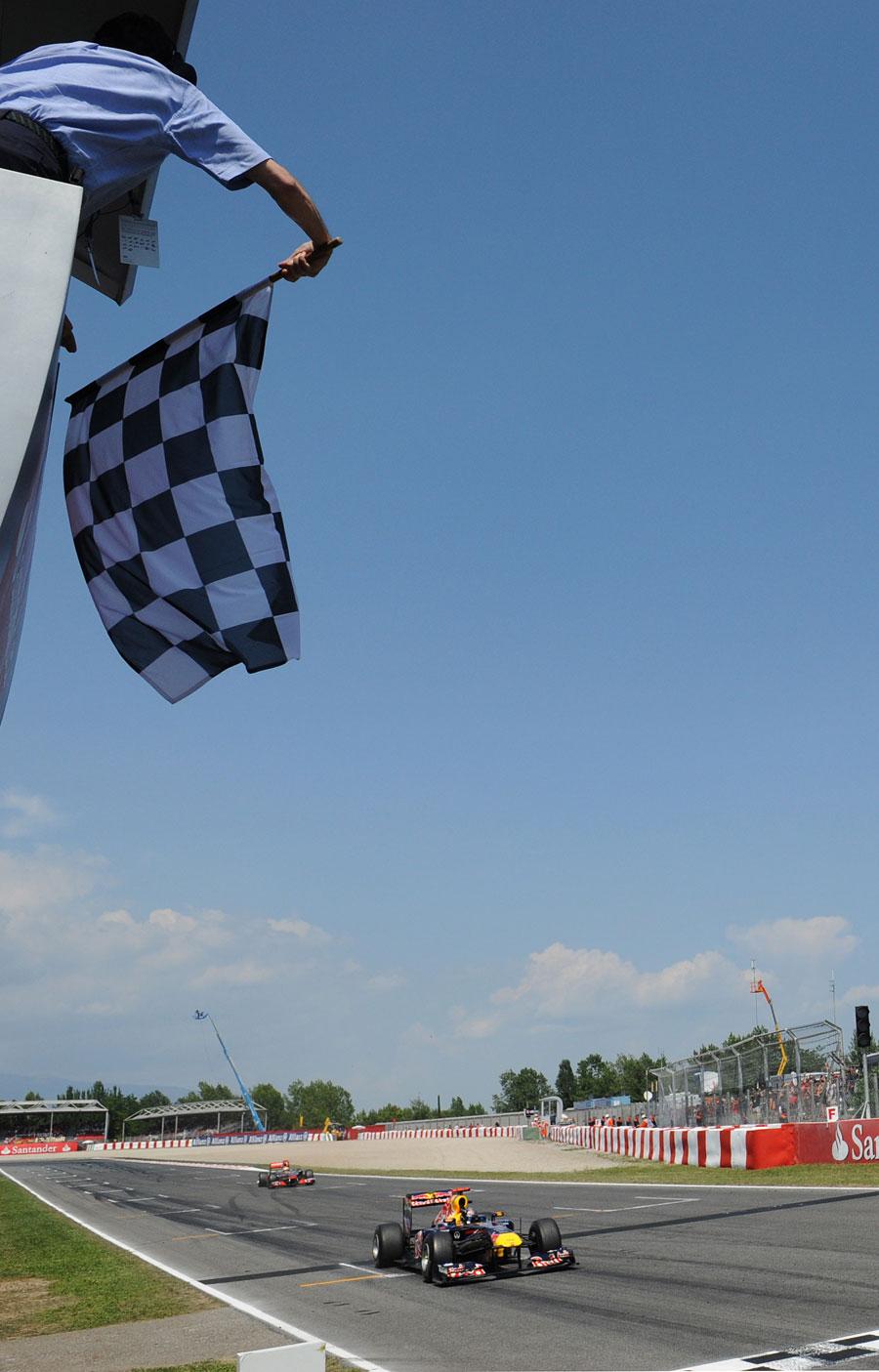 Sebastian Vettel leads Lewis Hamilton across the line