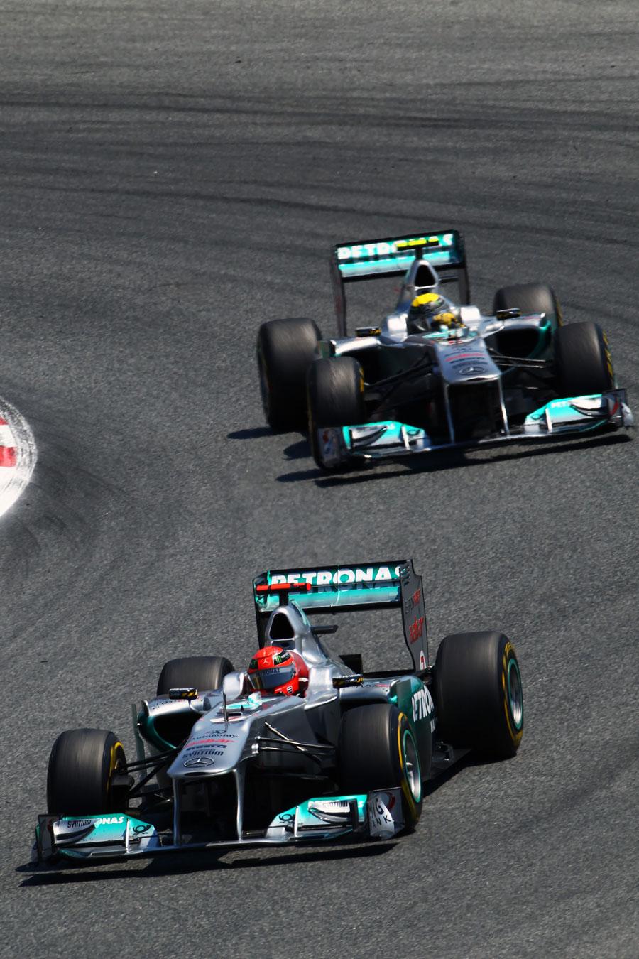 Michael Schumacher leads Nico Rosberg