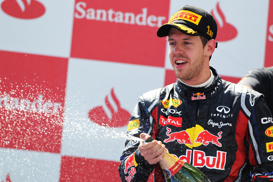 Sebastian Vettel sprays champagne after taking his fourth victory of the season