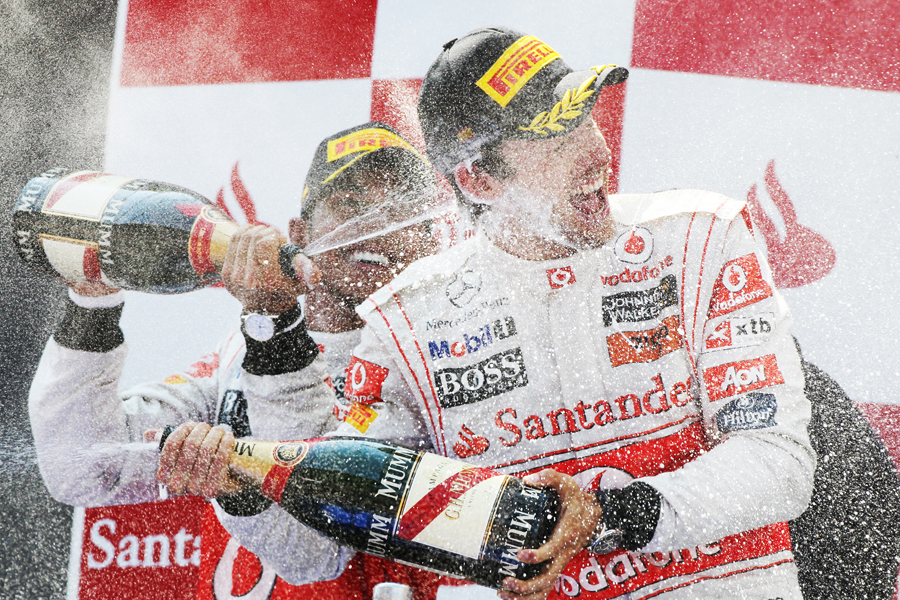 Lewis Hamilton and Jenson Button celebrate on the podium