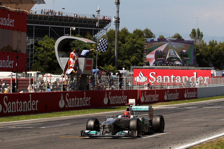 Michael Schumacher takes the chequered flag
