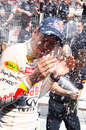 Sebastian Vettel is bathed in champagne after taking his fourth victory of the season