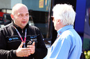 HRT team principal Colin Kolles talks to FIA technical delegate Charlie Whiting in the paddock before the race