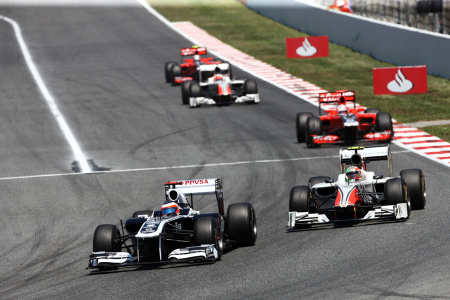 Rubens Barrichello leads the Tonio Liuzzi in to turn one