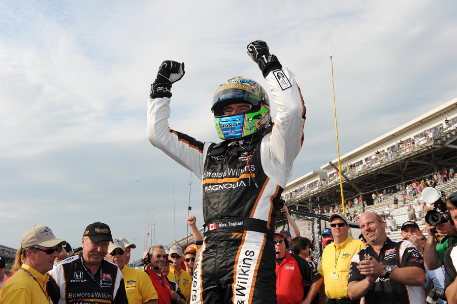 Alex Tagliani celebrates pole position after qualifying at the Indianapolis 500