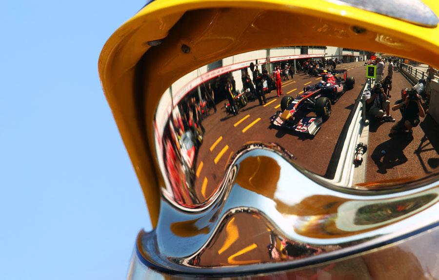 Daniel Ricciardo is reflected in a marshals visor