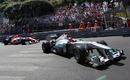 Michael Schumacher leads Narain Karthikeyan