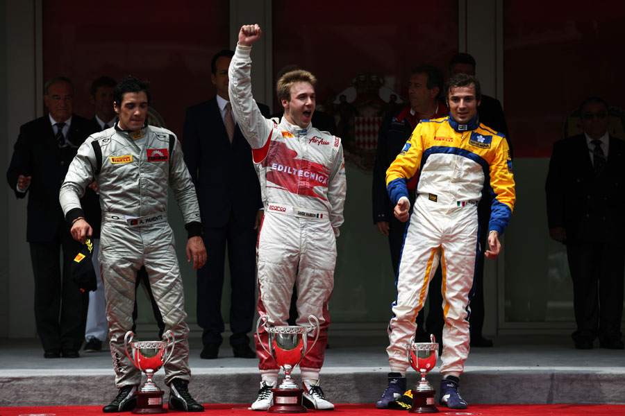 Davide Valsecchi celebrates his win in the GP2 feature race on the podium with Alvaro Parente and Luca Filippi