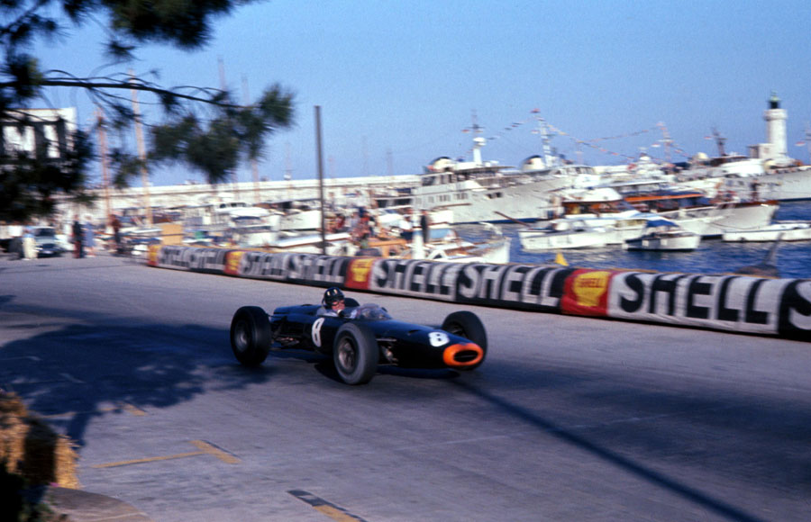 Graham Hill blasts past the harbour on his way to victory