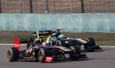 Vitaly Petrov puts a move on Heikki Kovalainen