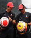 Jenson Button and Lewis Hamilton compare their special diamond-encrusted helmets
